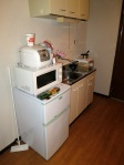 The kitchenette is equipped with a rice cooker, microwave, fridge/freezer and an IH (Induction Heater).